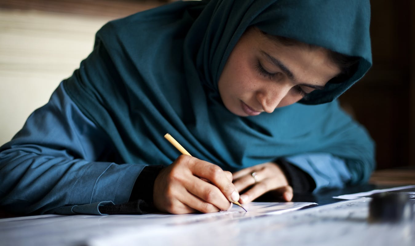 14 a Calligraphy student